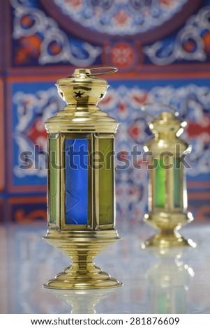 Group of Two Super Shiny Lanterns over Ramadan Fabric - stock photo