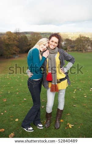 Group Of Two Teenage Female Friends In Autumn Landscape - stock photo