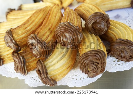 Group of typical churros at a stall, Spain. - stock photo