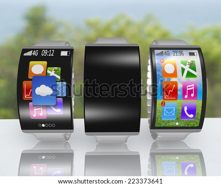 group of ultra-thin curved screen smartwatch with metal watchband on desk and nature background - stock photo