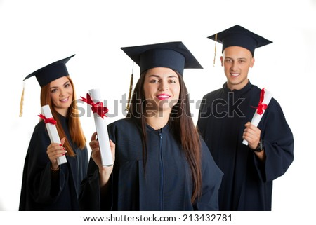 group of university student in graduation gown standing isolated on white background - stock photo