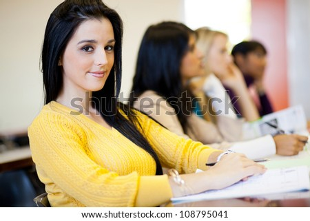 group of university students sitting in classroom - stock photo