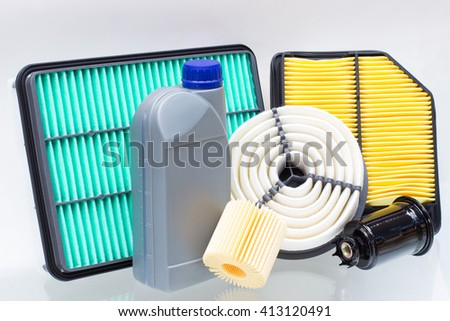 Group of various automotive filters and a liter bottle of motor oil or brake fluid. The horizontal arrangement of the picture - stock photo