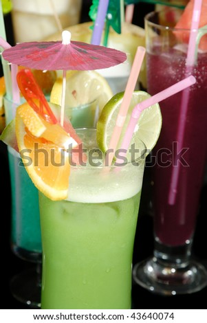 group of Various fresh cocktails on black background - stock photo
