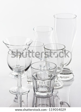 Group of various glasses on white background - stock photo