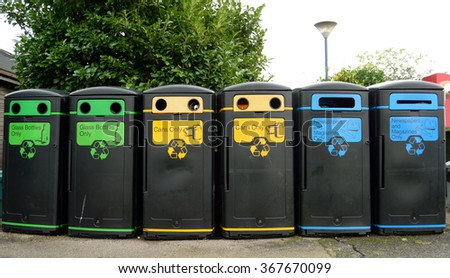 Group of various recycling bins in a row - stock photo