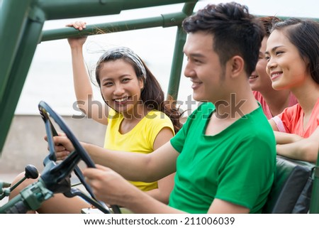 Group of Vietnamese friends traveling by off-road vehicle - stock photo