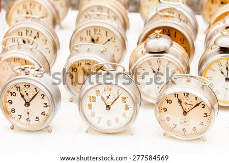 Group of vintage clocks at market
