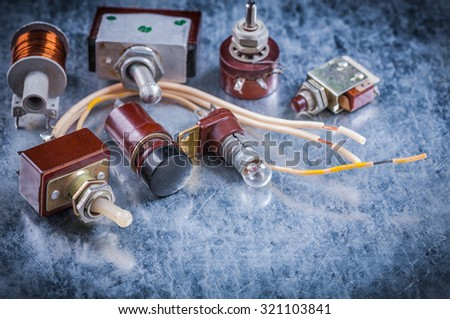 Group of vintage electrical equipment on metallic background electricity concept.