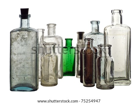 Group of vintage medicine bottles; isolated on white ground - stock photo