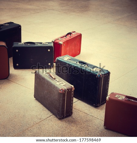 group of vintage suitcase on tiled floor - stock photo
