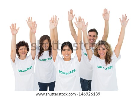 Group of volunteers raising arms on white background