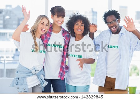 Group of volunteers standing together in a modern office - stock photo