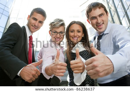 Group of white collar workers express positivity - stock photo