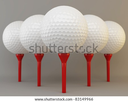 Group of white golf balls on brown tees - stock photo