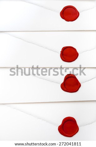 group of white letters closed by red sealing wax - stock photo