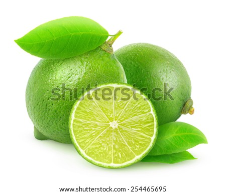Group of whole and cut fresh limes with leaves over white background, with clipping path - stock photo