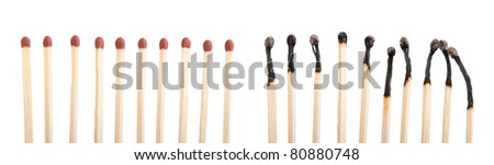 group of whole brown matches and burnt matches (isolated on a white background)