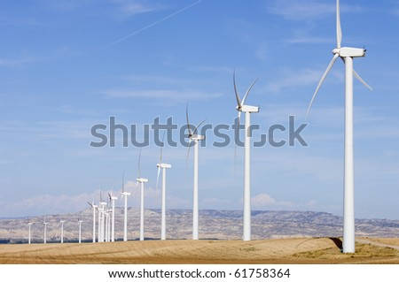 group of wind turbines for renewable electric energy production - stock photo