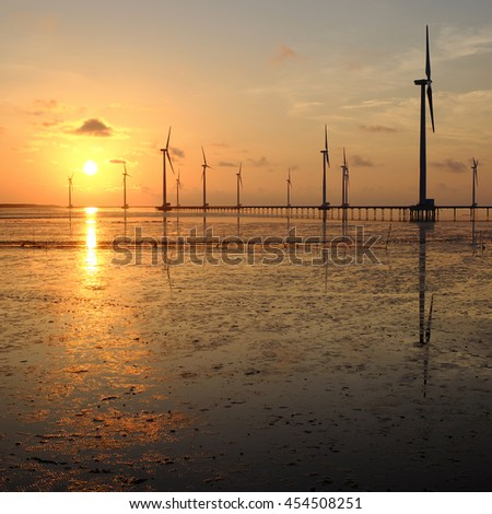 Group of wind turbines of Bac Lieu wind power plant at Mekong Delta, Vietnam. Windmill at Baclieu seaside at sunrise, make clean energy for Viet nam industry