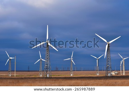 Group of windmill for renewable electric energy production, landscape, cloud, sky - stock photo