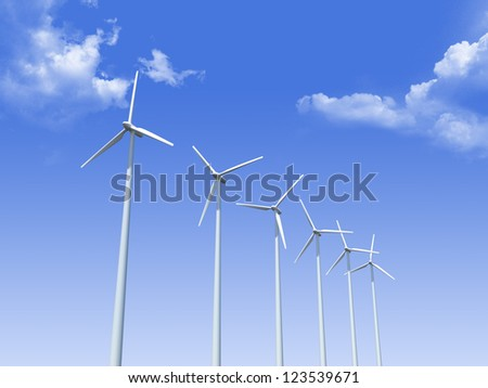 Group of windmills against blue cloudy sky.