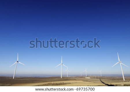 group of windmills for electric power generation alternative - stock photo