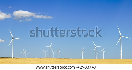 group of windmills with blue sky - stock photo
