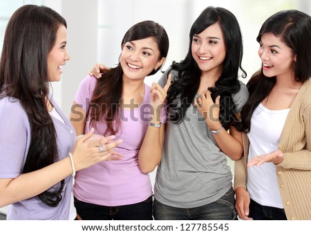 group of woman friend talking together and smile - stock photo