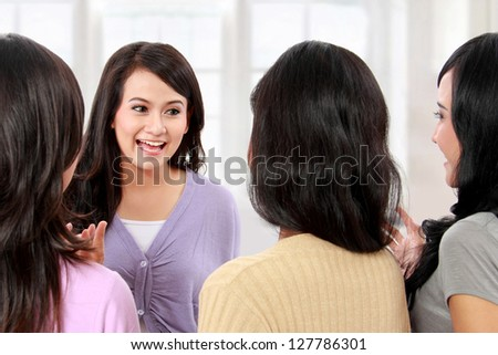 group of woman friend talking together and smile