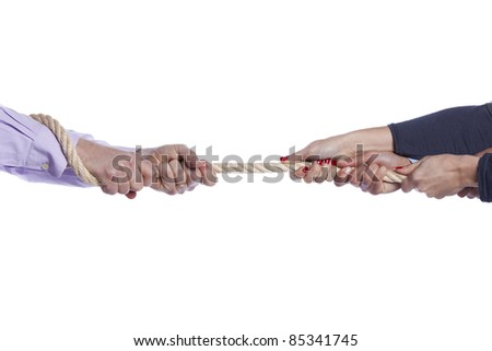 Group of woman hands pulling a rope competing with a man (selective focus) - stock photo