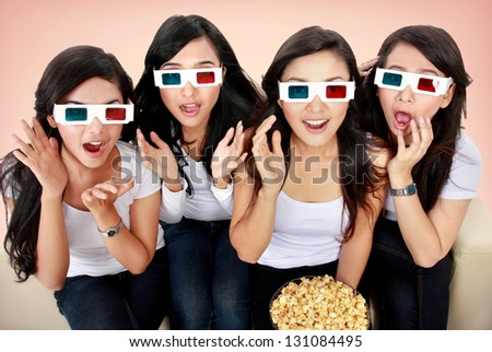 Group of woman watching movie with shocking expression - stock photo