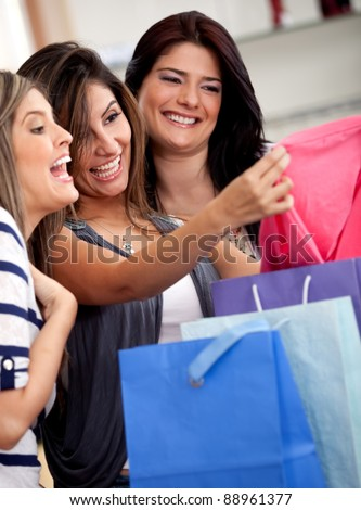 Group of women at a retail store shopping for clothes