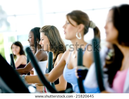 group of women doing cardio in a gym - stock photo