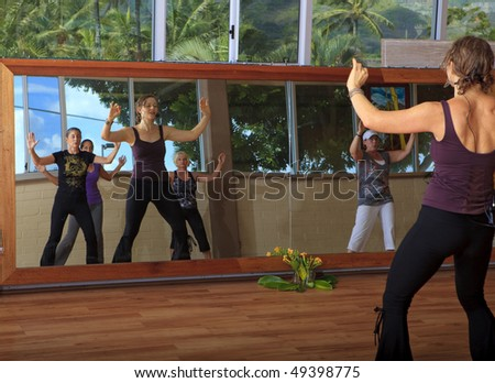 group of women in a nia exercise class - stock photo