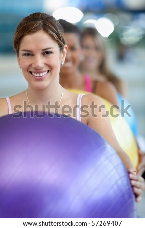 Group of women in a pilates class at the gym - stock photo