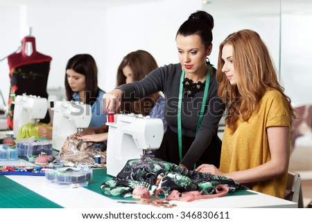 Group of women in a sewing workshop - stock photo