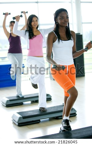 group of women in a steps class at the gym - stock photo