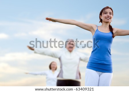 Group of women in a stretching class outdoors ? fitness concepts - stock photo