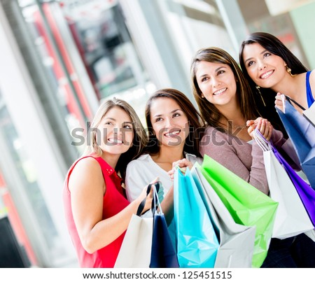 Group of women looking away at the shopping center - stock photo