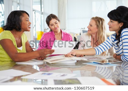 Group Of Women Meeting In Creative Office - stock photo