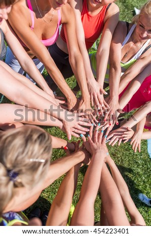 Group of women putting their beauty hands together stylish colorful nails art manicure