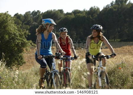 Group of women riding mountain bike - stock photo