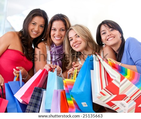 group of women shopping in a mall with some bags