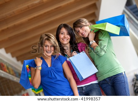 Group of women shopping in a mall with some bags - stock photo
