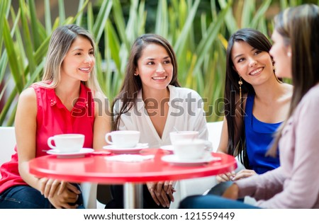 Group of women talking over a cup of coffee - stock photo