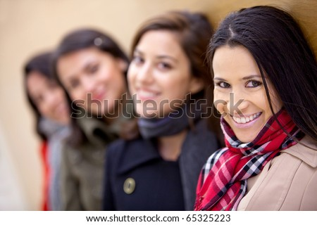 Group of women wearing warm clothes and smiling - stock photo