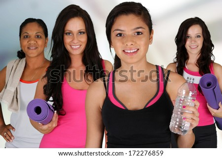 Group of women working out at the gym - stock photo