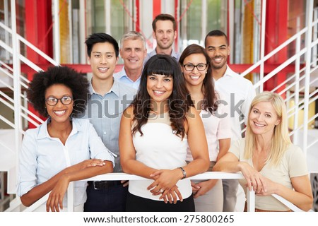 Group of work colleagues standing in an office lobby - stock photo