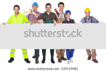 Group of workers presenting empty banner. Isolated on white - stock photo